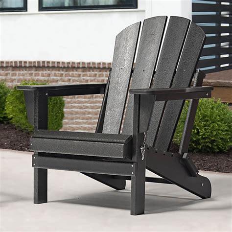 Black resin adirondack chairs Image