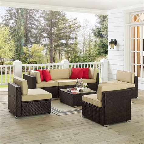 Carmelo 7 Piece Rattan Sectional Seating Group with Cushions