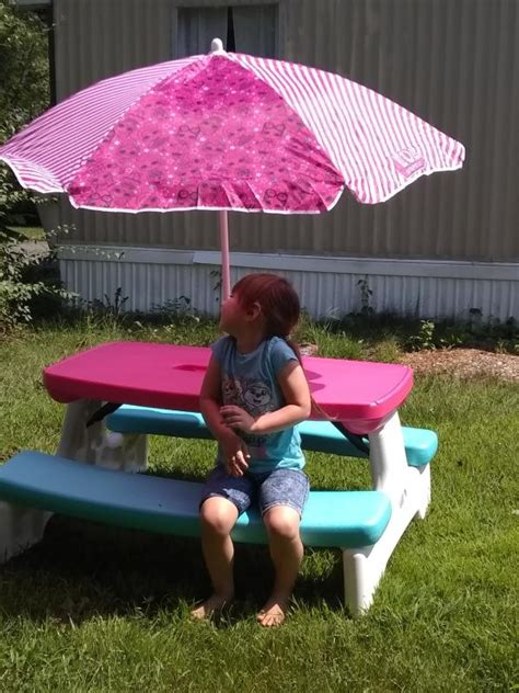 Childrens wooden picnic table with umbrella Image