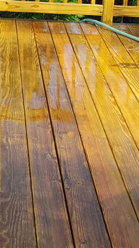 Cleaning pressure treated wood deck Image