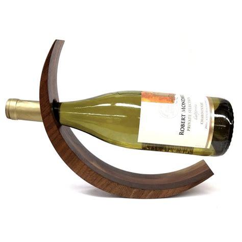 Curved wine bottle holder Image