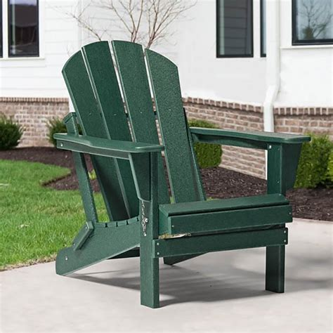 Dark green plastic adirondack chairs Image