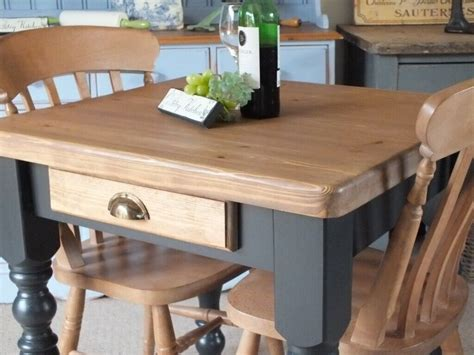Farmhouse kitchen table with drawers Image