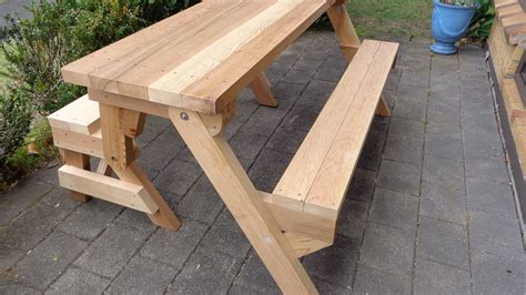 Folding picnic table made out of 2x4s Image