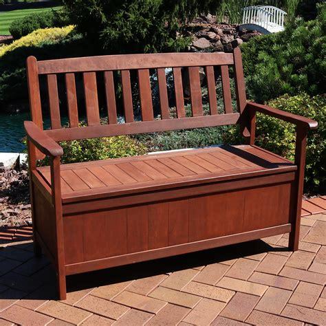 Garden wooden bench with storage Image