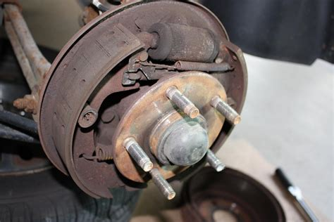 Taurus-Question How To Adjust Rear Brakes 2003 Ford Taurus.