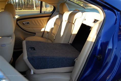 Taurus-Question How To Folding Down Seat 2003 Ford Taurus.