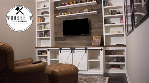 How to make a sliding barn door entertainment center faux barn wood floating shelf Image