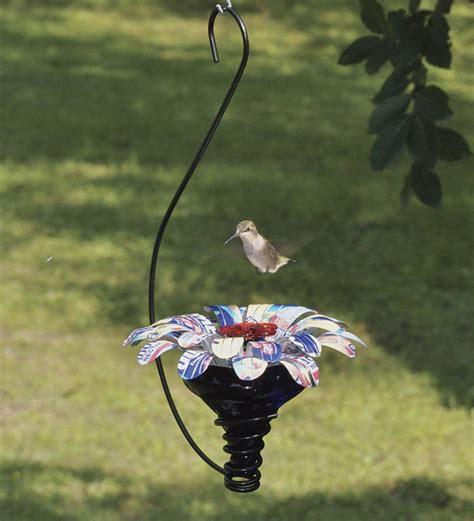Humming bird feeder hooks Image
