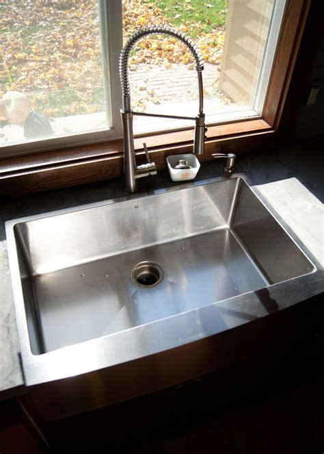 Installing apron front sink Image