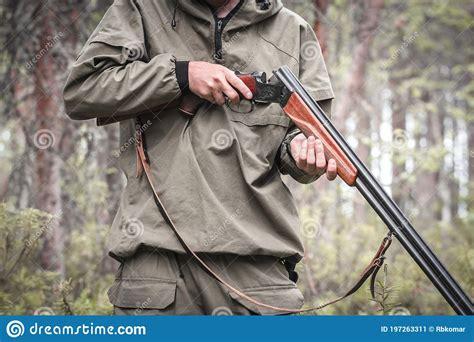 Man Holding Hunting Rifle