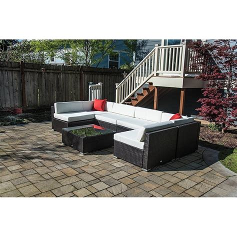 Mazie 7 Piece Rattan Sectional Seating Group with Cushions