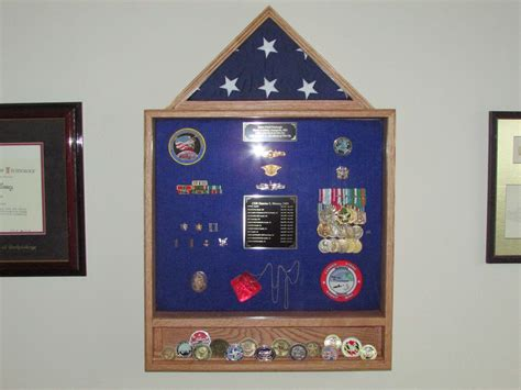 Military shadow box with built in coin rack Image