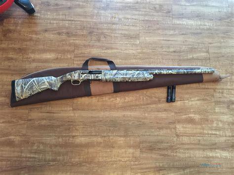 Mossberg Camo Semi Auto Shotgun And Mossberg Military Pump Shotgun