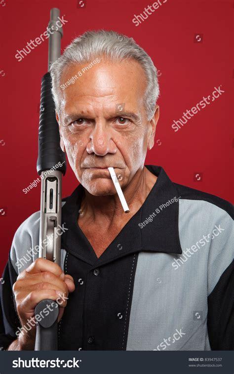 Old Man With A Shotgun Stock Image