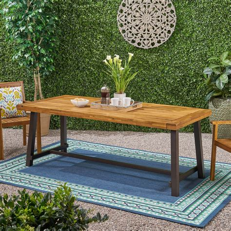 Outdoor wood table Image