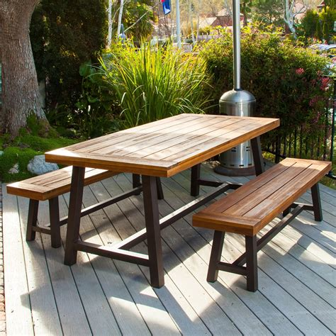 Outdoor wooden table and bench set Image