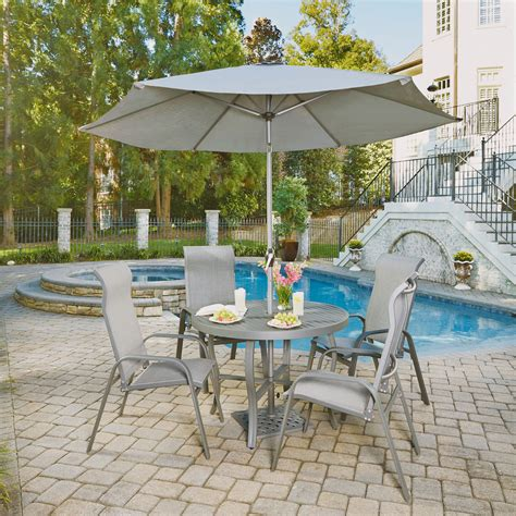 Outside table and chairs with umbrella Image