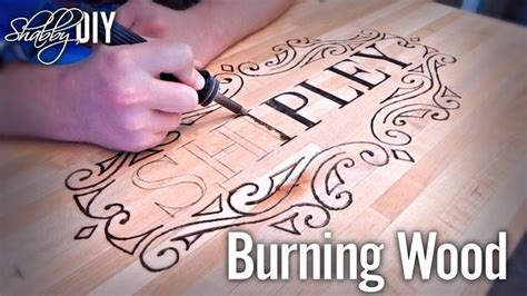 Personalize wood furniture using a woodburner tool Image
