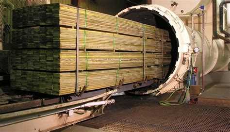 Pressure treatment of wood Image