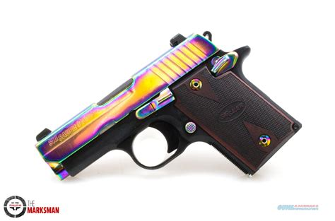 Rainbow Titanium 9mm Handgun With Laser Sight