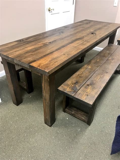 Rustic farmhouse dining table with bench Image