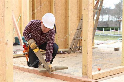 Sawing wood Image