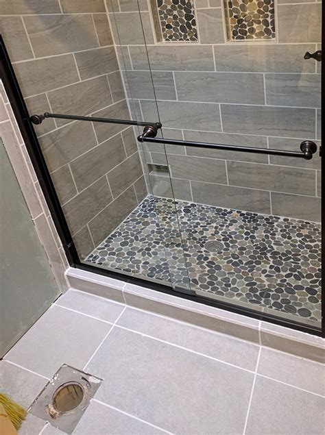 Shower floors with pebbles Image
