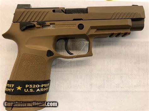 Sig Sauer 9mm Desert Tan And Sig Sauer Airsoft Pistol Spring