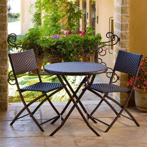 Small patio table and chairs Image
