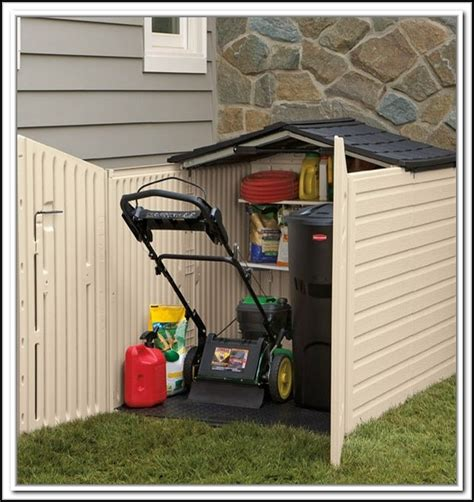 Small storage shed for lawn mower Image