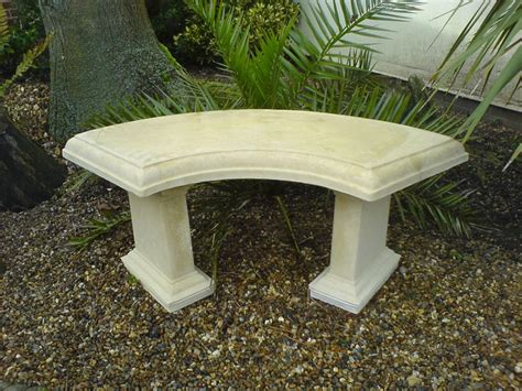 Stone outdoor table with bench seats Image