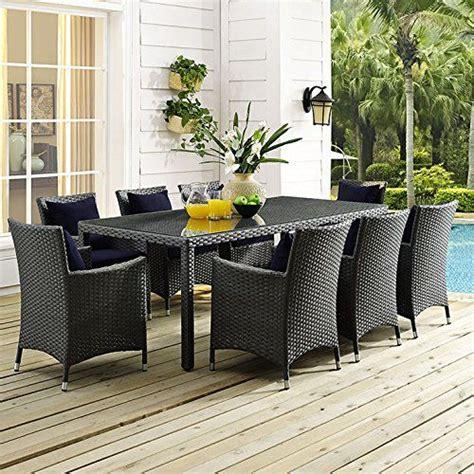 Tripp 9 Piece Dining Set with Sunbrella Cushions