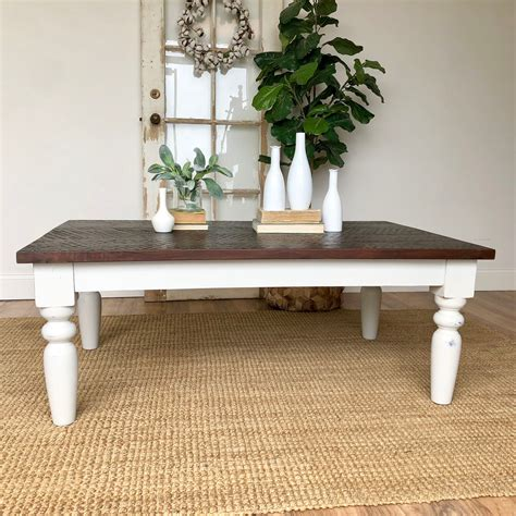 white farmhouse coffee table with light wood on top