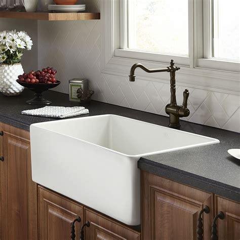 White farm style sink Image