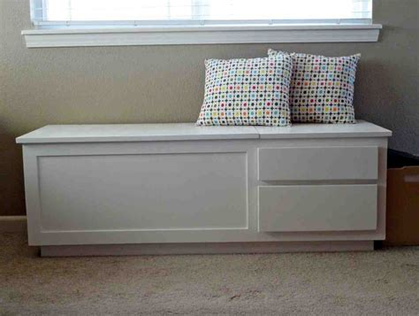 White wooden bench with storage Image
