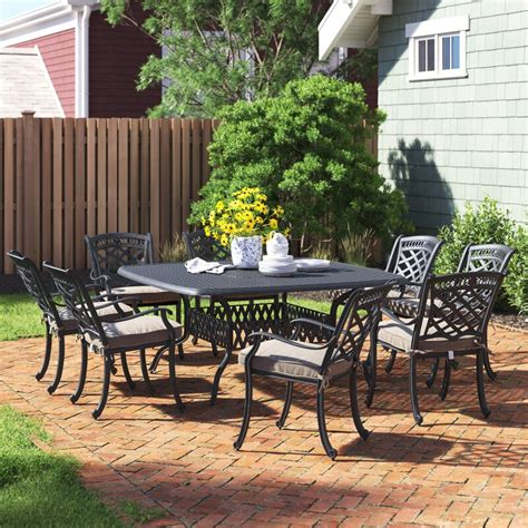 Wildermuth 9 Piece Dining Set with Cushions