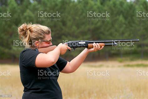 Woman Shooting Shotgun Home Security
