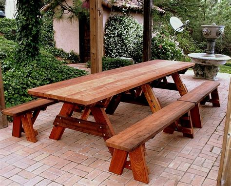 Wood picnic table and benches Image