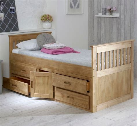 Wooden bed with storage Image