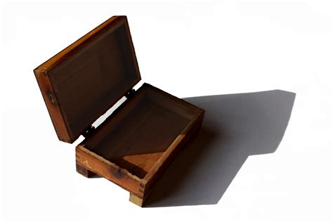 Wooden box with hinged lid Image