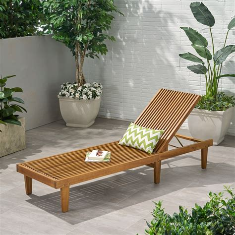 Wooden chaise lounge chairs Image