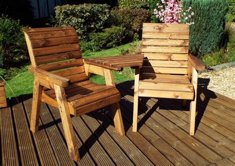 Wooden garden seat with table Image