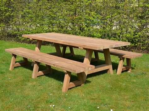 Wooden garden table and bench Image