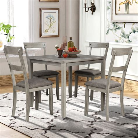 Wooden kitchen table and chairs Image