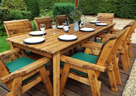 Wooden outdoor table and chairs Image