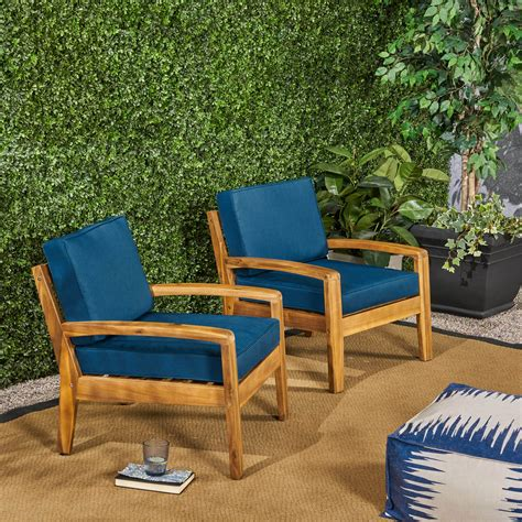 Wooden patio chairs Image
