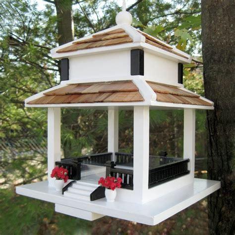 Wooden platform bird feeders Image