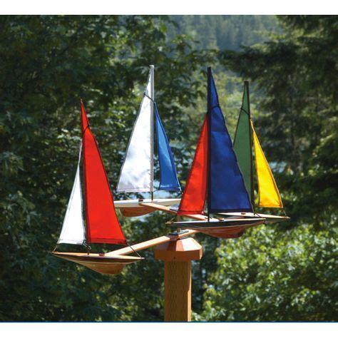 Wooden sailboat whirligig Image