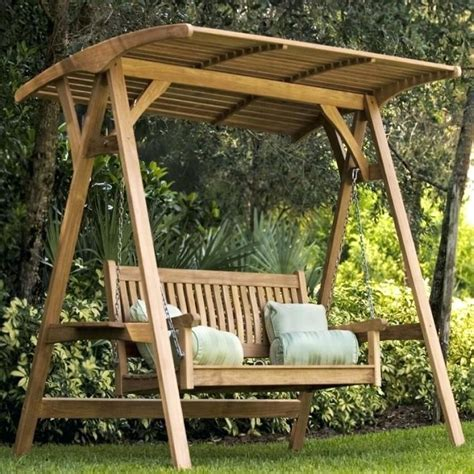 Wooden swing with canopy Image